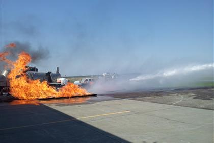 Airport Fire truck Extinguishing a Practice Fire